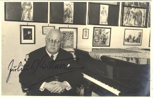 Attractive signed postcard photograph of the noted Viennese composer in a music studio, seated at an Ehrbar piano. Julius J. BITTNER.