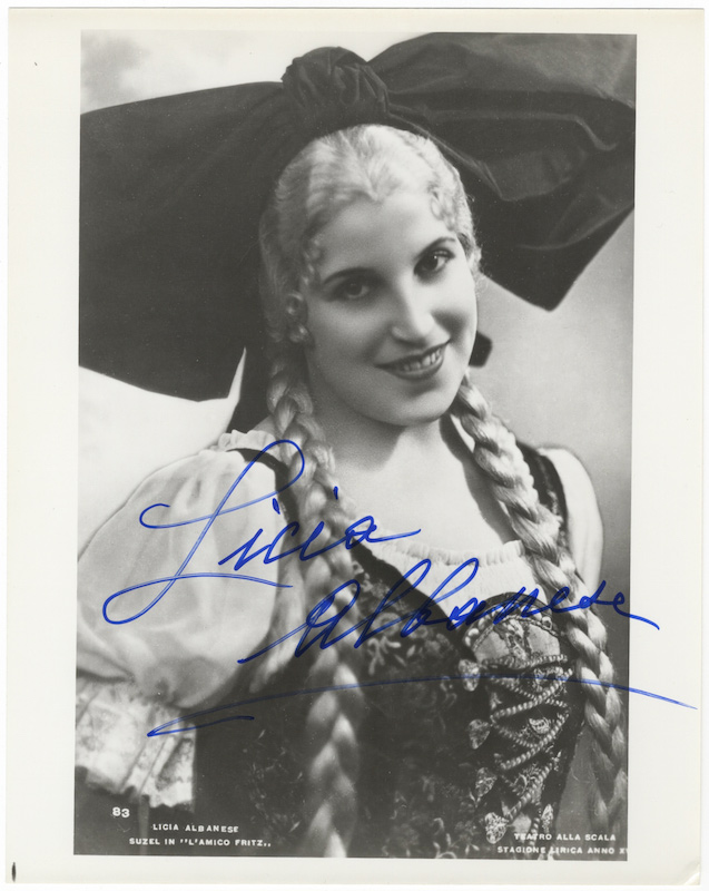 Role portrait photograph of the soprano as Suzel in Mascagni's L'Amico Fritz. Signed in full. Licia ALBANESE.