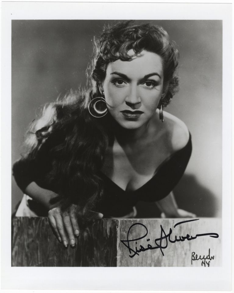 Bust-length role portrait photograph in the title role of Bizet's Carmen, signed in full. Risë STEVENS.