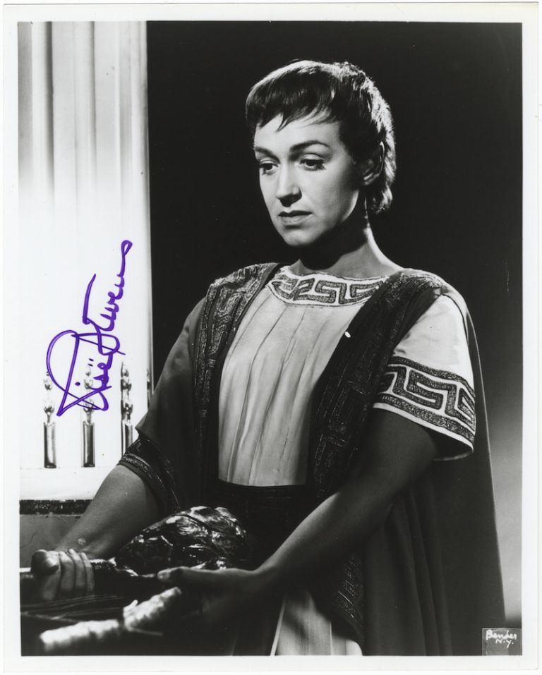 Half-length role portrait photograph in the title role of Gluck's Orfeo, signed in full. Risë STEVENS.