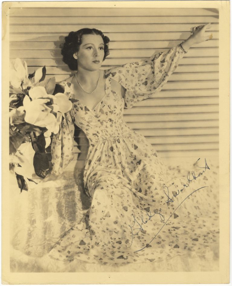 Three-quarter length photograph in formal attire, signed in full. Gladys SWARTHOUT.