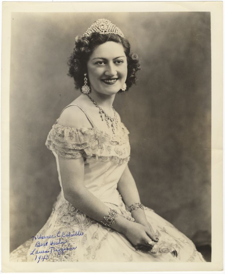 "Three-quarter length role portrait photograph of the soprano as Violetta in Verdi's La Traviata, signed in full, inscribed ""To Warner E. Colville Best Wishes,"" and dated 1943. Laura fl. 1940s TRIGGIANI."