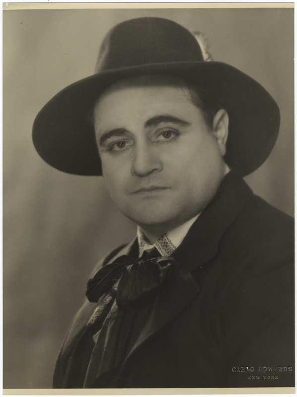 Original bust-length photograph by Carlo Edwards, New York, of the celebrated Italian tenor with hat and cravat. Beniamino GIGLI.
