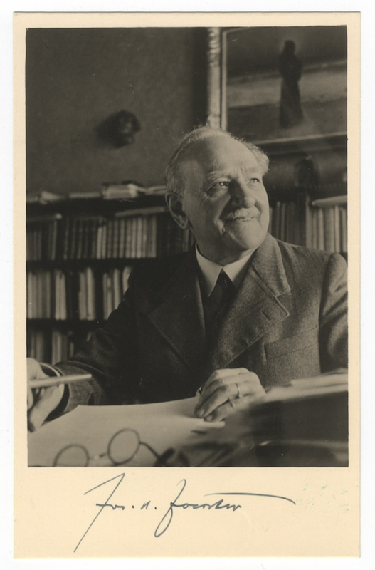"Bust-length vintage postcard photograph of the composer seated with pen poised over paper signed ""Jos. B. Foerster"" Josef FOERSTER."