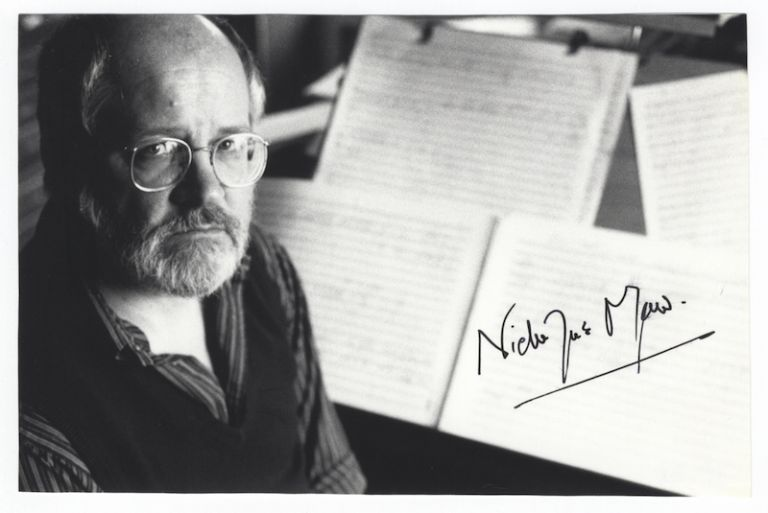 Bust-length portrait photograph of the English composer depicted seated with musical scores in background. Signed. Nicholas MAW.