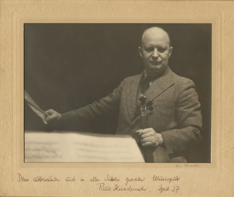 Fine original photograph by Eric Schaal, New York. Signed in full by the composer and inscribed to Associated Music Publishers. Paul HINDEMITH.