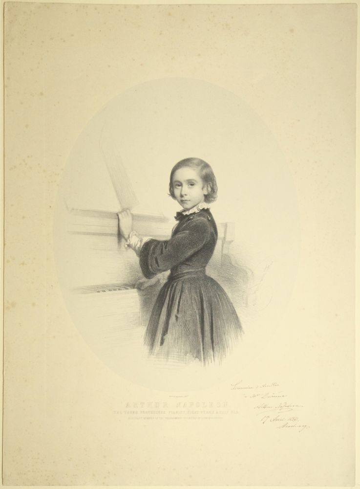 "Fine large lithograph by Charles Baugniet (1814-1886) of the Portuguese child prodigy pianist and composer aged 8-1/2. With an autograph inscription signed ""Arthur Napoleon"" and dated April 17, 1856, Strasbourg in ink to lower right portion of mount. Arthur NAPOLEÃO."