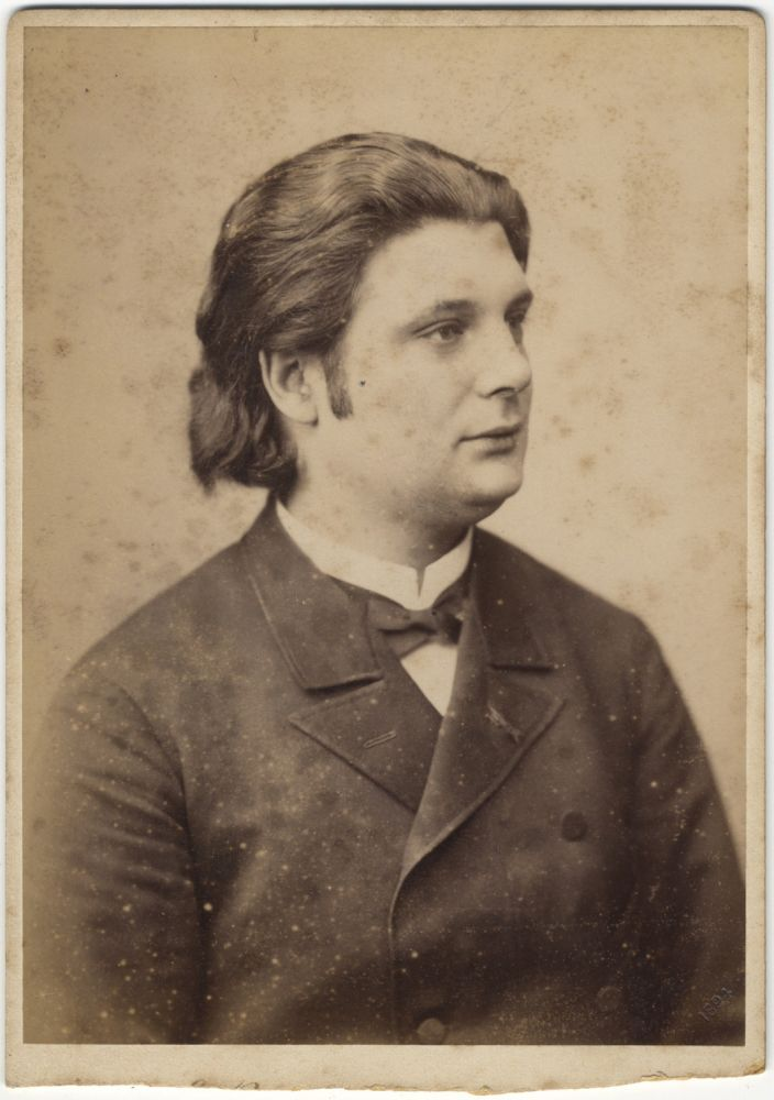 Original 19th century cabinet card photograph of the distinguished violinist looking left, half-length. Eugène YSAŸE.