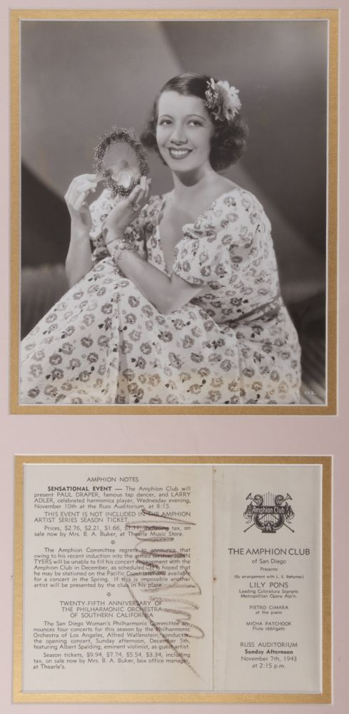 Program excerpt for a performance at The Amphion Club, San Diego, November 7, 1943. Signed in full by Pons in black crayon. Double matted in pink and gold in an ornate gilt frame together with a three-quarter length photograph of Pons. Lily PONS.