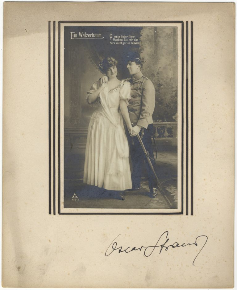 "Autograph signature on mount below vintage postcard photograph of characters from the composer's operetta ""Ein Walzertraum."" Oscar STRAUS."