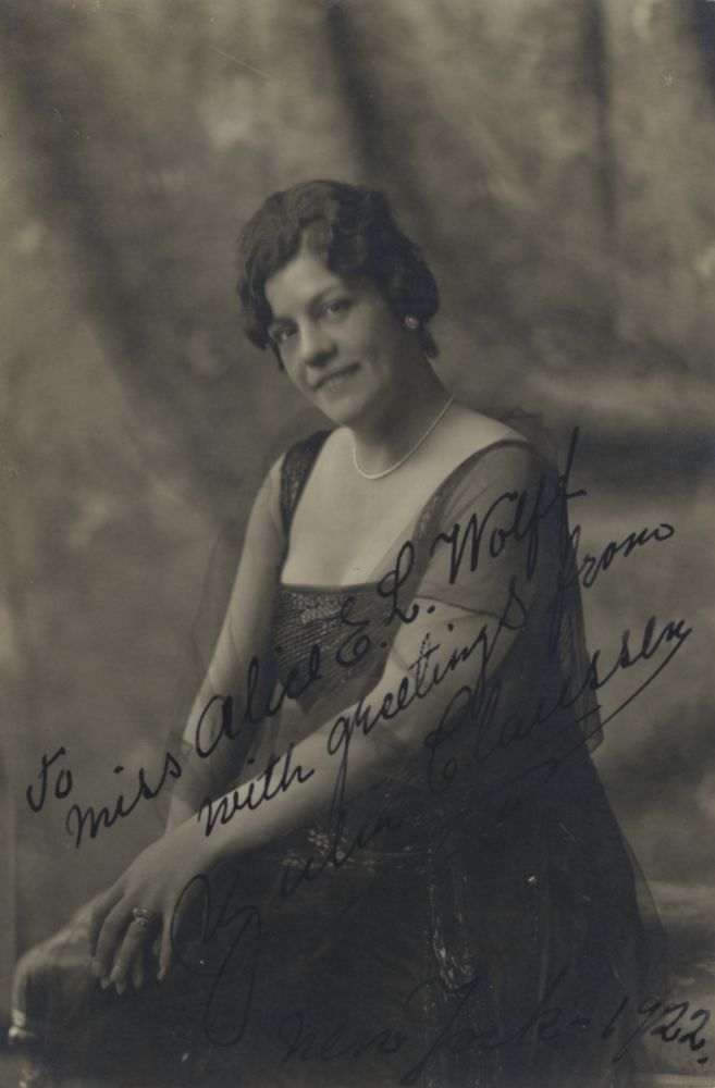 Three-quarter length photograph of the noted Swedish mezzo-soprano, seated, in formal dress. Signed in full, dated New York, 1922, and inscribed to Alice E.L. Wolff. Julia CLAUSSEN.