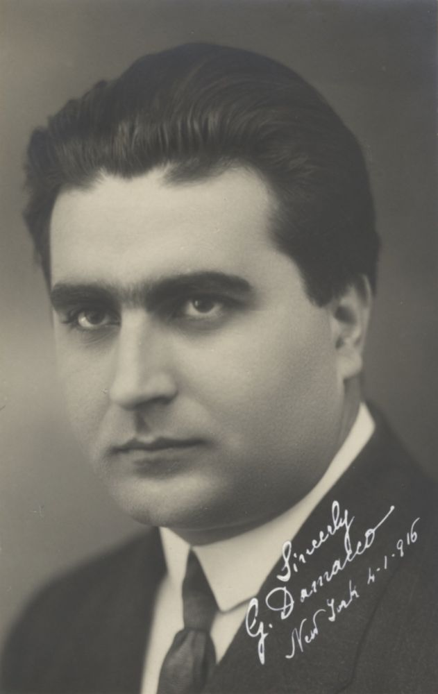 "Bust-length postcard photograph of the Italian tenor. Signed ""G. Damacco"" and dated ""New York 4-1-[1]916"" at lower right corner in white ink. Giacomo DAMACCO."