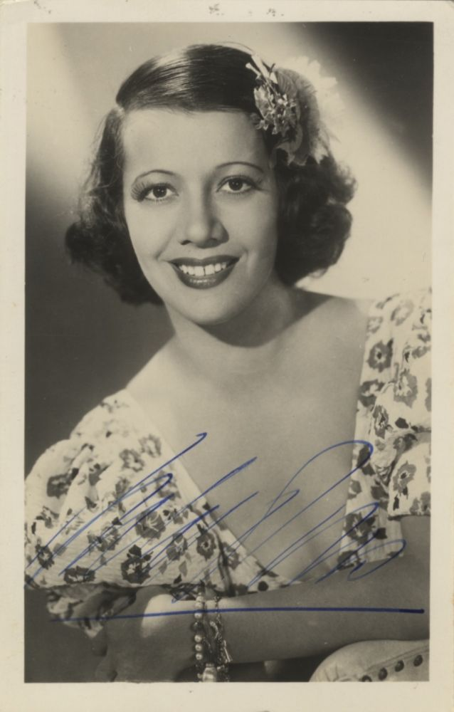 Signed bust-length portrait photograph of the noted French-born American soprano, ca. 1940. Lily PONS.