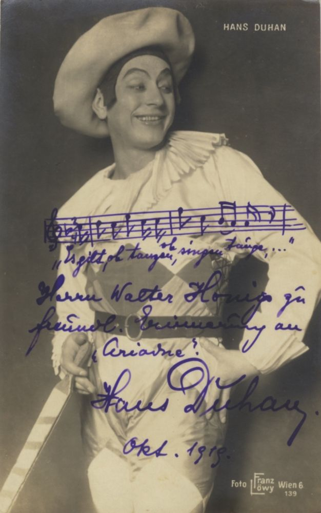 Role portrait postcard photograph with autograph signature of the Austrian baritone as Harlequin in Ariadne auf Naxos dated October 1919. Addressed to Walter Honig in Vienna. Hans DUHAN.