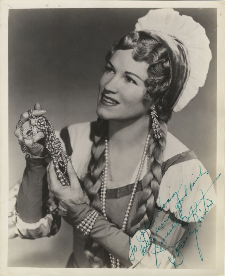 Role portrait photograph with autograph signature of the American soprano. Dorothy KIRSTEN.