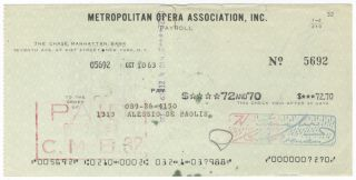 Autograph signature on verso of a Metropolitan Opera Association check in payment for services...
