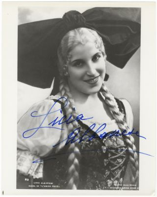 Role portrait photograph of the soprano as Suzel in Mascagni's L'Amico Fritz. Signed in full....