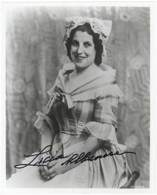 Role portrait photograph of the soprano in Mozart's The Marriage of Figaro. Signed in full. Licia...