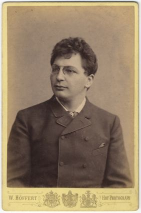 Bust-length cabinet card photograph in formal attire. Karl SCHEIDEMANTEL.