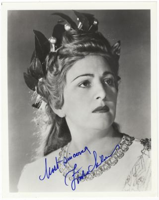 Bust-length role portrait photograph of the soprano in the title role of Bellini's. Zinka MILANOV