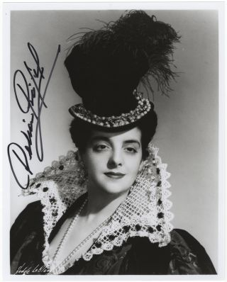Bust-length role portrait photograph of the soprano as Elisabeth in Verdi's Don Carlos, signed in...