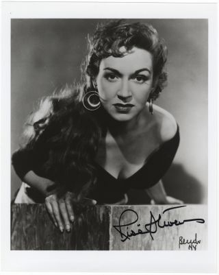 Bust-length role portrait photograph in the title role of Bizet's Carmen, signed in. Risë...