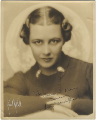 Bust-length portrait photograph, signed in full and inscribed to Clarence E. Krause. Gladys...