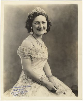 Three-quarter length role portrait photograph of the soprano as Violetta in Verdi's La Traviata,...