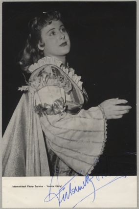 Waist-length role portrait photograph in costume in an unknown role, signed in full. Antonietta...