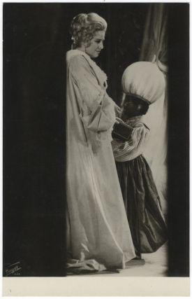 "Full-length role portrait photograph of the soprano as the Marschallin with a young blackamoor in Richard Strauss's Der Rosenkavalier. With an autograph inscription signed to verso: ""Frau Friedl Ullmann, in memory of May 1, 1970 with many thanks and all good wishes!"" Sena JURINAC."