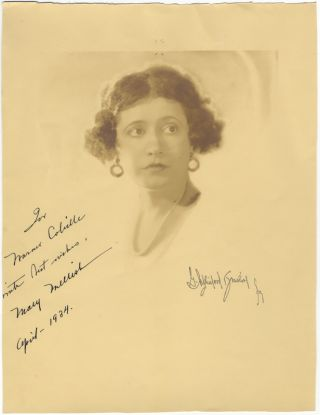 Large head-and-shoulders photograph signed in full, dated April 1934, and inscribed to Warner....