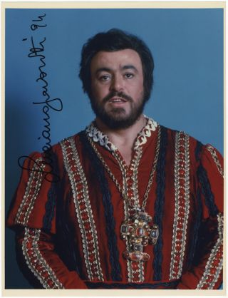 Large half-length colour role portrait photograph of the tenor as the Duke of Mantua in Verdi's Rigoletto. Signed in full and dated [19]94. Luciano PAVAROTTI.