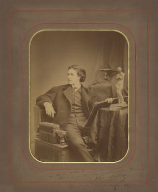 Original three-quarter length portrait photograph of the dashing young dramatist, seated with...
