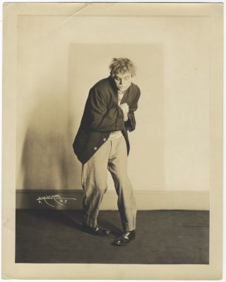 Original full-length role portrait photograph of the prominent American baritone as Tonio in Leoncavallo's Pagliacci together with cut signature laid down to ivory paper mount