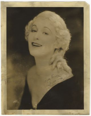 "Large bust-length photograph signed in full, dated 1932, and inscribed ""To Sam [...] Merry Xmas from your 'Dubarry' Grace Moore... "" Grace MOORE."