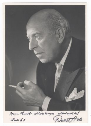 "Bust-length photograph of the noted Austrian composer and conductor in formal attire, cigarette in hand, signed, inscribed ""Herrn Emil Mösslinger allerherzlichst,"" and dated September [19]65. Robert STOLZ."