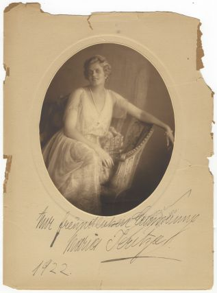 "Striking original oval photograph of the distinguished soprano in formal dress by Franz Xaver Setzer in Vienna, inscribed and signed in full by Jeritza on the mount: ... ""Mit freundlichen Erinnerung... 1922"" and also signed and dated by the photographer in pencil ""Setzer Wien 1921"" on the mount. Maria JERITZA."