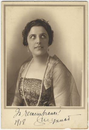 Fine large bust-length photograph of the famed soprano in formal dress boldly signed. Geraldine...