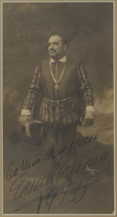 "Fine original photograph by the New York photographer Mishkin of Caruso in the role of Raoul in Meyerbeer's Les Huguenots. Signed, with an autograph inscription ""To Miss May Hiscose"" dated 1915. Enrico CARUSO."