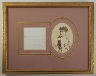 Autograph note signed in full with an original photograph.