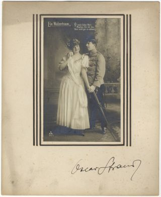 Autograph signature on mount below vintage postcard photograph of characters from the composer's....