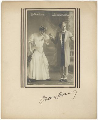 Autograph signature on mount below vintage postcard photograph of characters from the composer's...