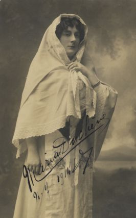 Three-quarter length postcard photograph of the French contralto in role portrait. Signed in....