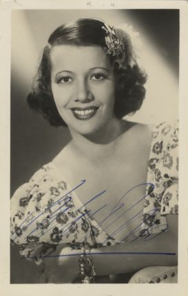 Signed bust-length portrait photograph of the noted French-born American soprano, ca. 1940. Lily...