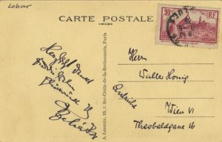 Postcard photograph of Notre Dame Cathedral with autograph signature
