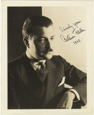 Studio photograph with autograph signature of the noted American conductor dated 1942. Arthur...