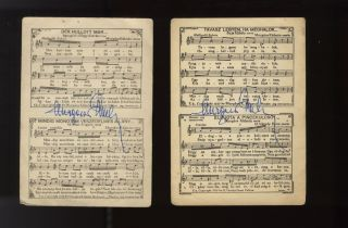 Two postcards with printed music, both with autograph signatures in blue ink....